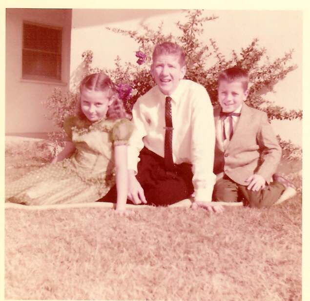 Sue Ken & Les Tiffany in front of rose bush Seven Sisters about 1955